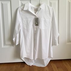 White button down High-low white blouse, a little sheer. NEVER WORN! GREAR CONDITION! Very soft material. Sleeves come down to the elbows or a little longer. Chico's Tops Button Down Shirts