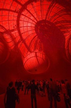 Leviathan by Anish Kapoor in the Grand Palais, Paris. Three 35 metre-high interconnected balloons, the sculpture has a dark purple skin and a translucent red interior. Silhouette of the palace ceiling is visible through the red rubber.