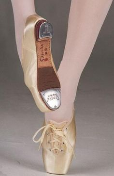"From Sansha, this combination pointe shoe is fitted with taps on ""Futura"" model pointe shoe. Small 3/4 inch heel. Special Order"