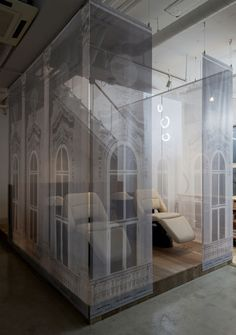Ghostly images of building facades decorate hanging fabric screens in a beauty salon in Omiya, Japan by Takara SpaceDesign