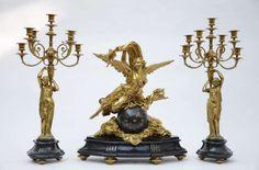 A gilt bronze clock set with an angel (59cm)