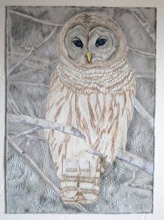Oliver by Karen Marchetti.  Exhibited at the 2011 International Quilt Festival - Houston in the annual IQA fall Judged Show, Quilts: A World of Beauty.  Posted at The Quilt show.