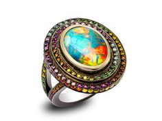 OPAL FRUIT RING-Solange Azagury-Partridge. An oval black Opal centre stone surrounded by tiers of Diamonds and pink Sapphires in blackened 18ct white gold