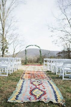Photographer: Amanda Lenhardt Photography via Style Me Pretty; This creative aisle runner takes the cake for a bohemian style wedding!