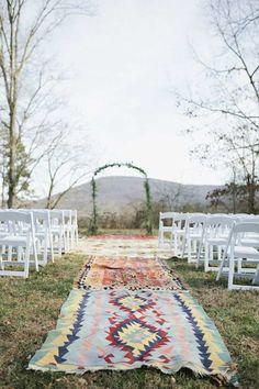 This creative aisle runner takes the cake for a bohemian style wedding! Photographer: Amanda Lenhardt Photography via Style Me Pretty