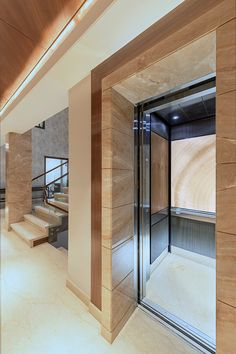 LEVELe-106 Elevator Interior with customized panel layout; Capture panels in ViviStone Cream Onyx glass with Standard finish, Bonded…