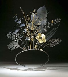 """Jan Yager, """"Tiara of Useful Knowledge,"""" 2006. Oxidized silver and gold."""