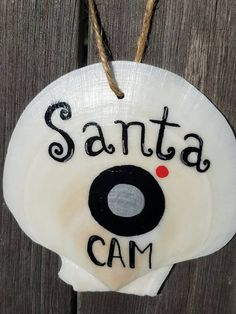 Check out this item in my Etsy shop https://www.etsy.com/listing/478074774/free-shipping-santa-cam-shell-ornament