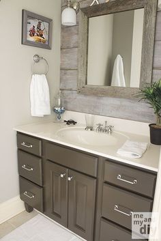Gray Painted Cabinets | Benjamin Moore Thunder Gray Bathroom Paint Color. Whitewashed backsplash.