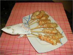 Aperitivos  Langostinos empanados con fideos de arroz