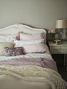 I don't think I could paint my bedroom cherry furniture white, but I sure like this color combo in the linens!