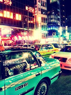 Tokyo Taxis jockey to whisk their tired passengers home for a short but hopefully fitful sleep