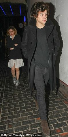 Low-key exit: Harry was spotted leaving through the back door of the club behind two mystery women