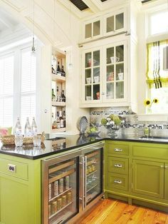 If you've got the space, build in mini beverage fridges in the cabinetry to save room in the main fridge. green lower white upper cabinets bhg