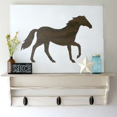 Learn how to make really large pieces of art like this wood horse stenciled wall art.