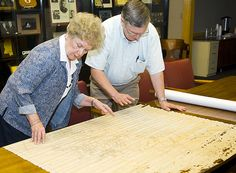 Mississippi State Dean of Libraries Frances Coleman and university archivist Mike Ballard examine a newly discovered 1907 map of Mississippi Agricultural and Mechanical College found inside a vault in Lee Hall.