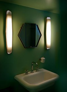 Even the bathrooms are beautiful at Caffe Burlot, Paris by DIMORE STUDIO, shapes of the long lights, mirror, sink + faucets are functional