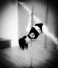 A kind of a Split variation: invert into Scorpio, twist the arm behind the neck for a good grip, hook inner leg, extend outer leg then release inner leg into a split