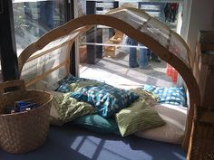 Adorable reading or nap nook at a daycare center - love this for a playroom or kids bedroom - natural waldorf inspired