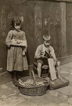 Girl and boy making kindling