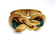 Joseff Coiled Snake Bracelet with Emerald Green Rhinestones Ethnic Jewelry, Luxury Jewelry, Modern Jewelry, Indian Jewelry, Antique Jewelry, Vintage Jewelry, Snake Bracelet, Snake Jewelry, Animal Jewelry
