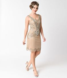 You'll be the haute hero of the evening! A graceful flapper dress by Frock and Frill in elegant nude, the Athena dress is an enchanting 1920s reproduction with a timeless turn! Crafted in lightweight lined mesh, with ornate hand beaded silver and gold sca