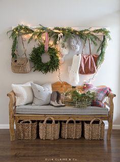 A cozy Christmas entryway with twinkle lights, classic reds and greens, and scarves. Christmas Entryway, Christmas House Lights, Indoor Christmas Decorations, Cozy Christmas, Green Christmas, Christmas Ideas, Simple Christmas, Christmas Ornaments, Christmas Interiors