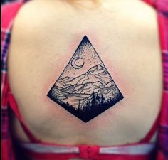 SUPERB looking nature view in night time. There's some huge mountains, fields and a flowing river. Everything is limited with a geometric figure and tattooed on a girl's back. :)