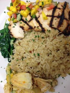 Grilled chicken with mango salsa, pineapple brown rice, and sautéed spinach