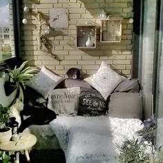 My DIY balcony chill corner with couch build by old wood that have been used before, madress and a lot of pillows