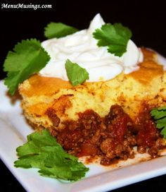 Cornbread Cowboy Chili -  Turn your favorite chile recipe into a comforting casserole.  Dip down through the sweet homy cornbread into the big bold flavor of chili, then made perfect with a cool scoop of sour cream and the brightness of cilantro.  Mix-dump-bake.