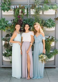 Perfect Pastel Wedding Details for a Spring Wedding | Mismatched Bridesmaid Dresses: One of the best things about pastels is they're soft enough that multiple hues play nice together without looking overpowering. These light blue mismatched bridesmaid dresses nail the trend with the perfect combo of delicate color and a variety of styles.