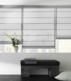 Aventura Roman Shade in Cotton White (The Shade Store) Over-sized drapery is thankfully now a thing of the past. Window treatments with a simple interior fitting represent today's modern home. Roller shades are the best accessory