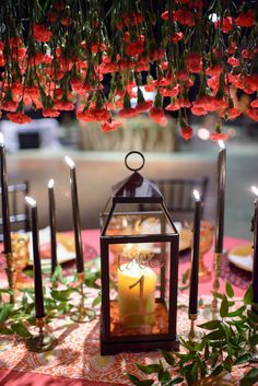 hanging centerpieces + lantern table number, photo by LH Photography http://ruffledblog.com/notwedding-orlando #weddingcenterpieces #weddingideas