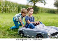 Two happy children playing with big old toy car in summer garden, outdoors. boy driving car with little girl inside. laughing and smiling kids. Christian Men, Grace Christian, Christian Quotes, Luxury Lifestyle Women, Inspirational Videos, Summer Garden, Old Toys, Faith In God, Happy Kids