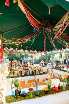 Astro turf table runners? Hahaha!  Pretty flowers! Rainbow Wedding :)