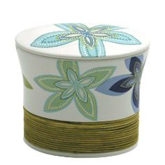 African Floral Cotton Jar (5Dx4H) by Creative Bath. $17.99. Ceramic,Rattan. Bring exotic flowers into your bathroom with our African Floral Bath Ensemble. The bath ensemble will brighten any bath décor with its unique floral design which features flowers done in multiple shades of purples, blues and greens. Choose from cotton jar, wastebasket, soap dish, tissue box, lotion pump or toothbrush holder. Each sold separately.. Save 10%!