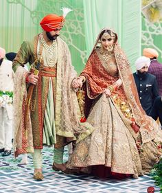 Beautiful Indian bride in grey maroon Rimple Harpreet Wedding Lehenga. There are different rumors about the real history of … Wedding Lehnga, Indian Bridal Lehenga, Indian Bridal Outfits, Sikh Wedding, Indian Bridal Wear, Punjabi Wedding, Wedding Couples, Bridal Dresses, Farm Wedding