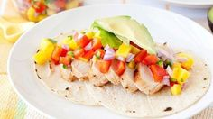 Fire up the grill! Our marinated Santa Fe Grilled Chicken is topped with fresh mango salsa and sliced avocados.