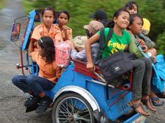 How many people can fit in this car?   In Pulau Samosir Sumatra Indonesia