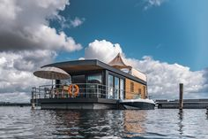 Bedroom: 2 each with a double bed Living room and dining area: 1 sofa bed Occupancy: max. Float Life, Floating Architecture, Shanty Boat, Houseboat Living, Living On A Boat, Water House, Canal Boat, Floating House, Double Beds