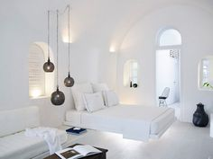 A 19th-century sea captain's home converted into a modern Santorini island cave. #white #minimalist #decor