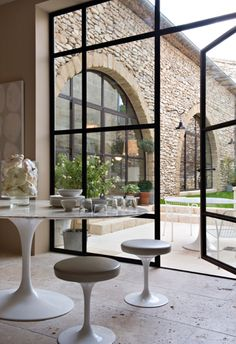 Things That Inspire: Steel Windows and Doors Steel Windows and Doors Remodelista of steel - framed windows Patio Interior, Interior And Exterior, Apartment Interior, Room Interior, Steel Doors And Windows, Big Windows, Modern Windows, Arched Windows, Metal Doors