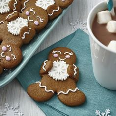 This team of gingerbread treats is happily showing their winter spirit with Wilton Royal Snowflake Icing Decorations. Simple lines, dots and swirls of royal icing give each treat a personality of its own.