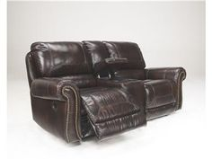 Shop for Signature Design DBL Rec Loveseat w/Console, 2100094, and other Living Room Loveseats at Comfy Couch Company in Columbus, OH. Leather Match upholstery features top-grain leather in the seating areas with skillfully matched vinyl everywhere else. With the plush back cushions beautifully adorned with jumbo stitching details and shaped rolled arms with nail head accents, the rich beauty of the Dexpen-Saddle upholstery collection offer style and comfort along with the function of ...