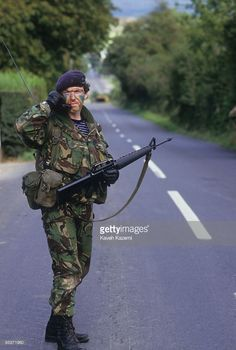 A British soldier standing in the middle of the road in Crossmaglen, Northern Ireland, fully equipped with automatic assault rifle, September He is talking on his radio whilst on the. Get premium, high resolution news photos at Getty Images