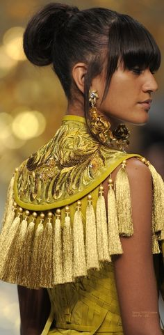 8/30/16 The reason why I chose this image was because this is an interesting mix of traditionally regarded upholstery features with couture. Guo Pei Spring 2016 Couture - EE