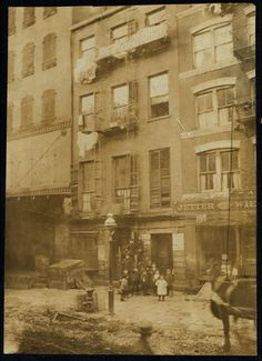 Tenement house with children in front. Possibly 36 Laight St. Location: New York, New York (State). Old Pictures, Old Photos, New York Photos, Nyc, Vintage New York, Lower East Side, Historical Pictures, New York City, Vintage Photography