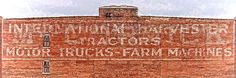 Mccormick International Harvester Ghost Sign Dwc - A faded ghost sign on top of an old brick building in the West Bottoms of Kansas City Missouri. An older McCormick sign was covered up by black paint that has completely faded away so it is now visible under the newer International Harvester tractors - motor trucks - farm machines sign. A digital water color filter of my own settings was applied to create a colorful art look that brings out the texture and accentuates the signage.