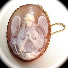Inspiring!  ===  20th Century Italian Shell Cameo of the Angel of Hope from cammei on Ruby Lane